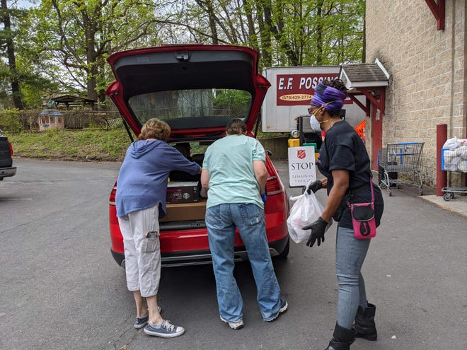 Volunteers from the East Stroudsburg Salvation Army Corps. Food Pantry load up a car with food in May, 2020. A golf tournament to benefit the organization will be held in Kresgeville in June.