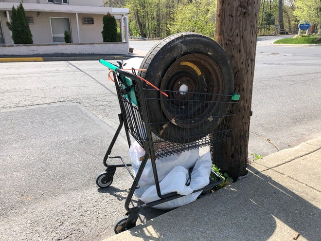 Trash bags and a tire await collection at Lenox Street and Park Avenue in Stroudsburg on Saturday, April 24, 2021 during the Pick Up the Poconos event hosted by the Pocono Mountains Visitors Bureau.