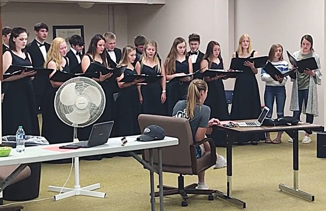 Members of the Pratt High School 2021 Chamber Choir sing for the USD382 Board of Education last Monday as part of their announcement that PHShas been selected to take part in a Carnegie Hall Choirs of American festival in March 2022.