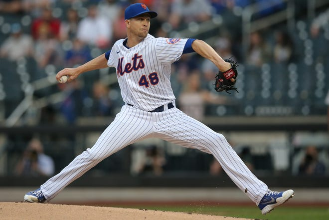 New York Mets starting pitcher Jacob deGrom delivers in the first inning Wednesday night against the Boston Red Sox  at Citi Field.