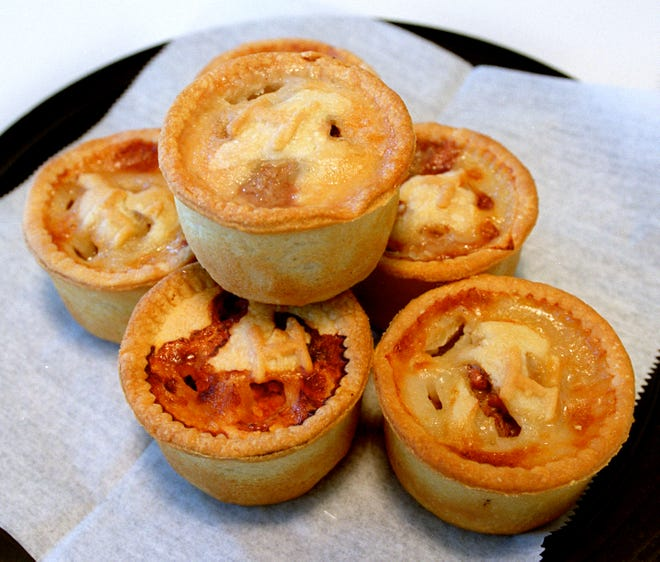 A stack of Hartley's pork pies.