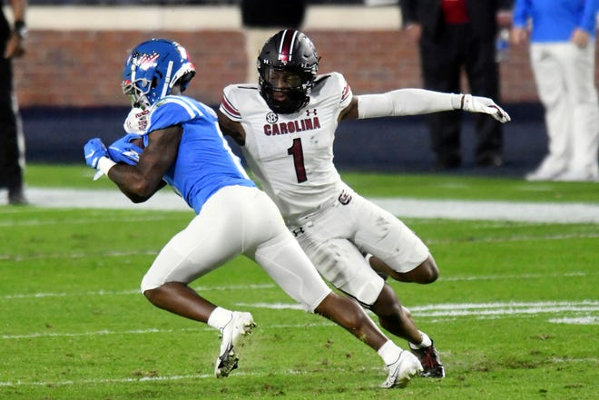 South Carolina defensive back Jaycee Horn, right, tackles Mississippi wide receiver Elijah Moore during the game Nov. 14 in Oxford, Miss. Horn is expected to be drafted early in this year's NFL Draft.
