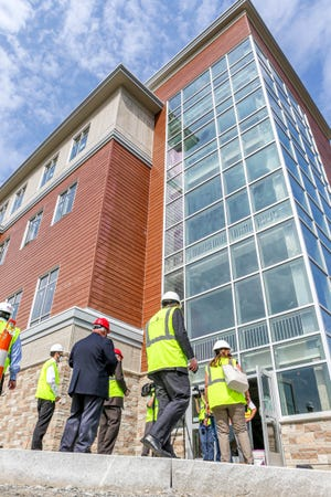 Towering glass and open spaces inside are hallmarks of East Providence's 304,000-ssquare-foot, four-story high school.