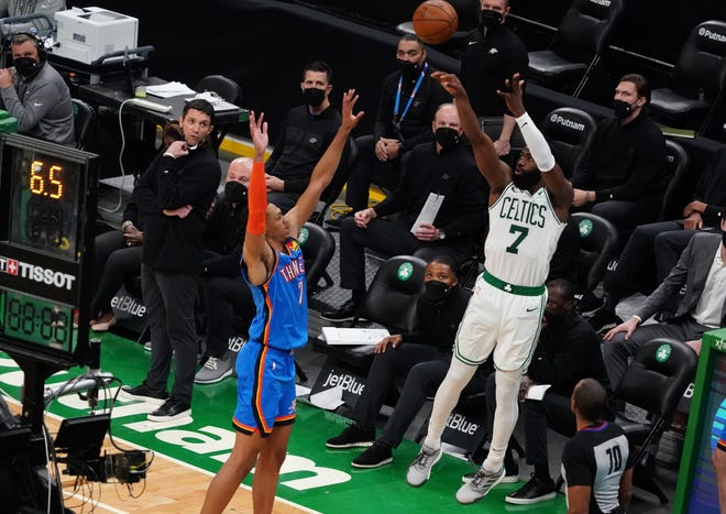 Celtics guard Jaylen Brown, right, shoots a 3-point basket over Oklahoma City Thunder forward Darius Bazley in the fourth quarter Tuesday night at TD Garden. Brown scored 39 points in the Boston loss.