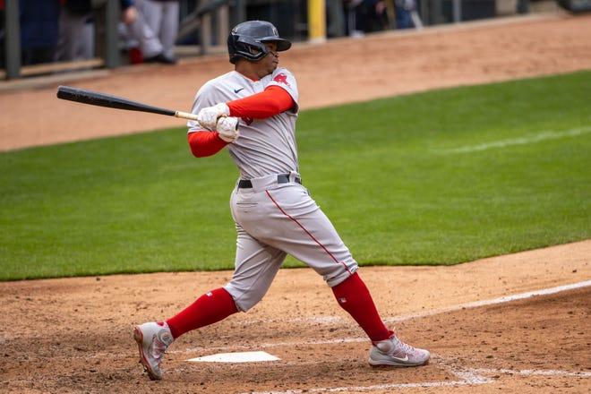 Apr 14, 2021; Minneapolis, Minnesota, USA; Boston Red Sox third baseman Rafael Devers (11) hits a single in the seventh inning against the Minnesota Twins at Target Field. Mandatory Credit: Jesse Johnson-USA TODAY Sports