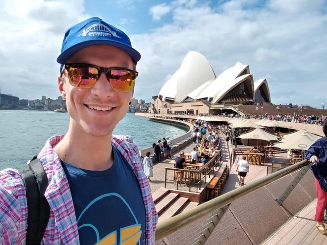 "Dillon Guyer, a Seacoast New Hampshire travel agent, takes a selfie during a prior trip to Australia. He said he's seeing a ""boom"" in vacation booking."