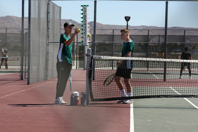 The Burroughs High School No. 1 doubles team, Ryan Cooper and Digby Anderson, take an early 3-1 lead over Sultana Monday afternoon.