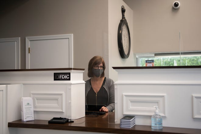 Beth Snyder, lead teller at the new Rootstown branch of Portage Community Bank, is ready to serve clients.