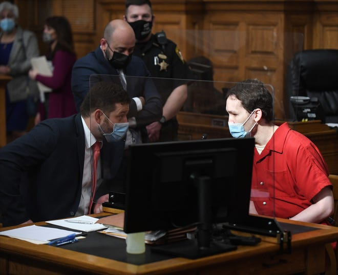 Attorneys Ty Graham, left, and Eugene Cazantzes, speak with Jacob Stockdale prior to his sentencing Wednesday in Stark County Common Pleas Court. Stockdale pleaded guilty to two counts of murder for killing his mother Kathryn and brother James in 2017.