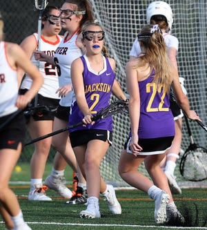 Riley Floyd (2) of Jackson celebrates her goal with Kenzie Adams (22) during their game at Hoover on Tuesday, April 27, 2021.