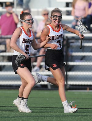 Lily Cain (3) of Hoover celebrates her goal with Lilly Altman (5) during their game against Jackson at Hoover on Tuesday, April 27, 2021.