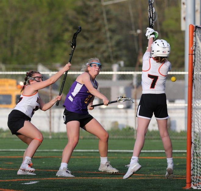 Chelsea Debevec (middle) of Jackson takes a shot at Hoover, April 27, 2021.