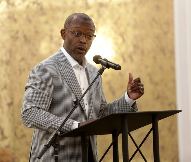 Melvin T. Gravely II, a former Canton resident who owns a construction business in Cincinnati, speaks Wednesday at the Stark County Minority Business Association program honoring local business owners who completed the Expanding Resources for All mentoring program.