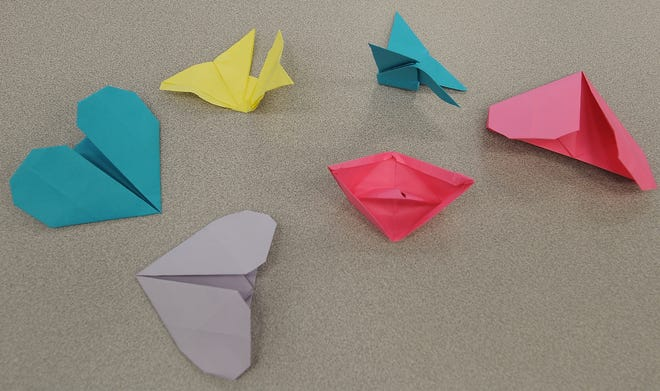 Sacred Heart Jr. - Sr. High School students learned how to do different types of origami during the annual culture fair on Wednesday.