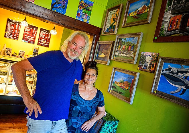 Theo and Diane Glorie, owners of the Coffee House Realty Café in St. Augustine, have decorated the walls of their new coffee shop with their paintings.