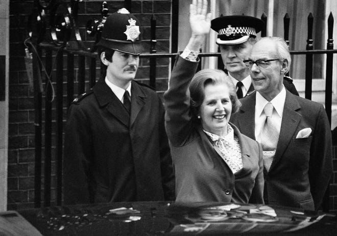 New British Prime Minister Margaret Thatcher and husband Denis arrive at 10 Downing Street on May 4, 1979 in London.