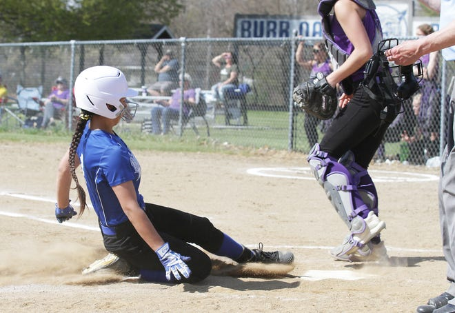 Burr Oak's Brooklyn Hernandez slides safely into home plate to score a run for the Lady Bobcats on Tuesday.