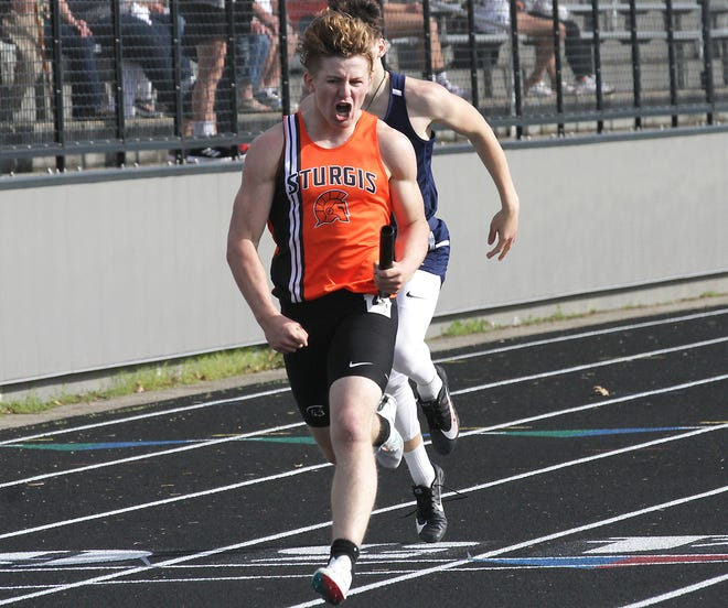 Brenden Myers of Sturgis celebrates after crossing the finish line in the 800 relay on Tuesday evening.