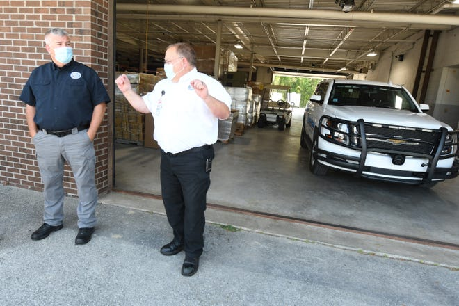 Brunswick County EMS Director Edward Conrow and Deputy Director Lyle Johnston talk outside the Brunswick EMS building in Bolivia about the growth of the county and nationwide need for more ambulances.