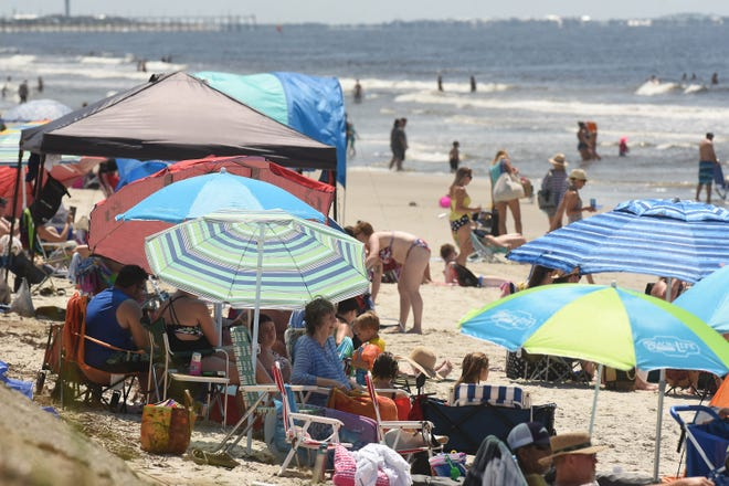 Beach goers enjoy the day during the N.C. 4th of July Festival Beach Day Saturday July 1, 2018, at the Middleton Park Extension in Oak Island, N.C.