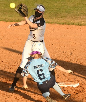 Topsail's #3 Sydney HartGrove catches the ball Hoggard's #6 Isabel Roberts slides into 2nd base as Topsail took on Hoggard Tuesday April 27, 2021 at home in Hampstead, N.C. as Topsail took on Hoggard Tuesday April 27, 2021 at home in Hampstead, N.C. Hoggard won 1-0 to clinch the MEC title. [KEN BLEVINS/STARNEWS]