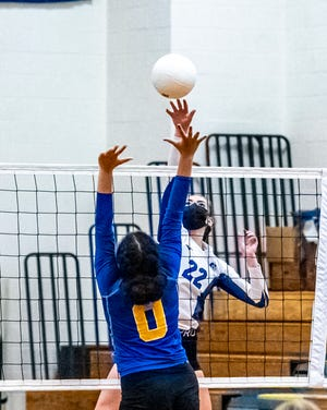 Fairhaven's Sarah DeSousa goes for the kill in the Blue Devils' 3-0 victory over Wareham.