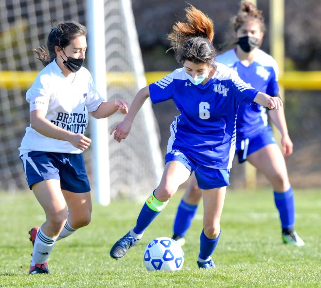 Bristol-Plymouth's Charis Banez, left, eyes the ball as Upper Cape's Angelina Rodolfo moves up field in Tuesday's game in Bourne.