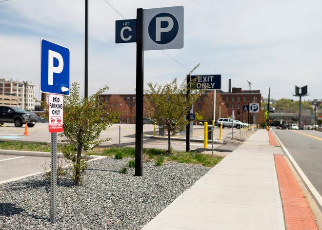 New parking measures have started popping up in the Canal District, including the lot next to the Worcester Ice Center, seen Wednesday.