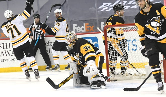 Bruins center  David Krejci (46) celebrates a goal with Taylor Hall (71) as the puck made it past Penguins goalie Tristan Jarry during the second period Tuesday night in Pittsburgh.