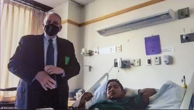 Attorney Robert Griffin represents defendant Dal Khan Mung during Mung's arraignment from his UMass Memorial Medical Center Hospital bed via Zoom on Wednesday.