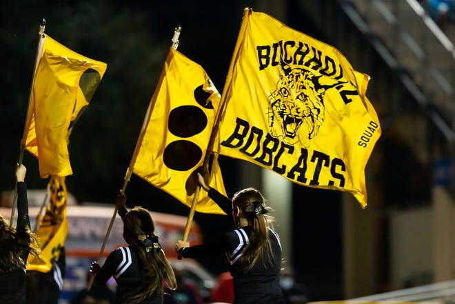 Buchholz Bobcats cheerleaders run onto the field after a touchdown in the third quarter during the Buchholz Bobcats football game against the Niceville Eagles in the regional semi-finals of the 2020 FHSAA Football State Championships 7A Playoffs at Citizens Field in Gainesville on Nov. 27.