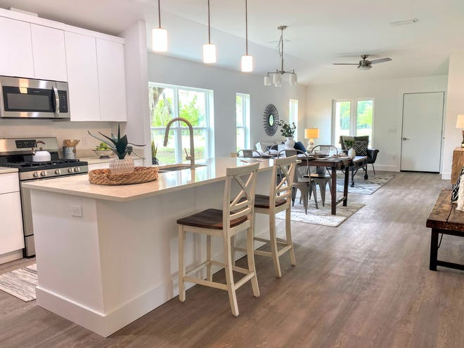 The kitchen, dining and living areas of the Red Maple model home at the Heartwood Subdivision, 1717 SE Eighth Ave., in Gainesville. The neighborhood will have 34 lots when completed, 11 of which will be exclusively used for affordable housing. [Submitted photo]