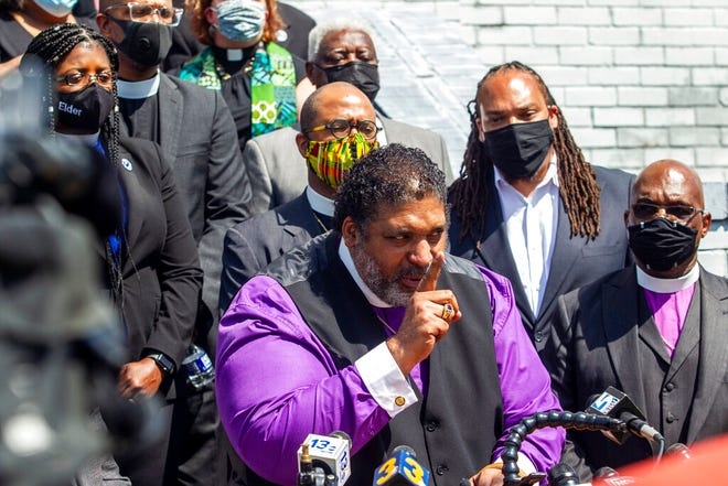 Rev. William Barber II speaks during a press conference in Elizabeth City as the North Carolina NAACP and clergy urge state Attorney General Josh Stein to take over the Andrew Brown Jr. shooting investigation. [Travis Long/The News & Observer via AP]