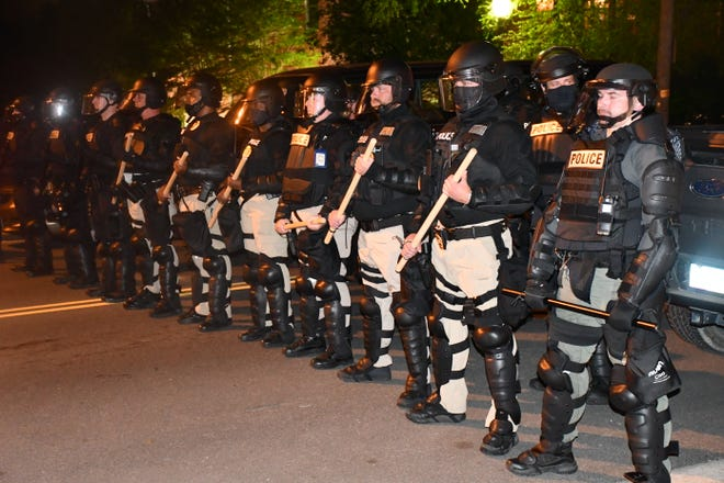 Police in riot gear prepare to quell the protests at the Water Street Bridge in Elizabeth City. Note: this photo was taken before Randolph County deputies arrived in Elizabeth City.
