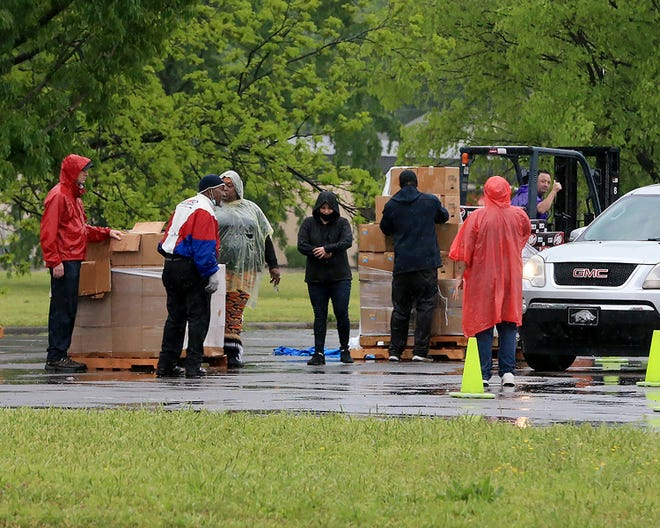 Antioch for Youth and Family staff and volunteers distribute USDA Farmers To Families food boxes and other donated groceries, Wednesday, April 28, at the Pop-Up In The Park pantry held in the parking lot at Martin Luther King Park in Fort Smith.