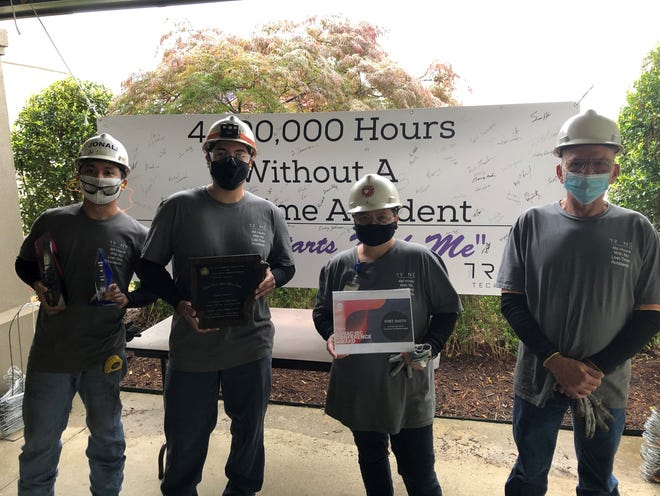 Trane Fort Smith employees Chris Acala, left, Brayan Juarez, Alice Noble and Lawrence Noble take part in recognition of Trane Fort Smith, receiving the Arkansas Department of Labor's Million Work Hour Award.