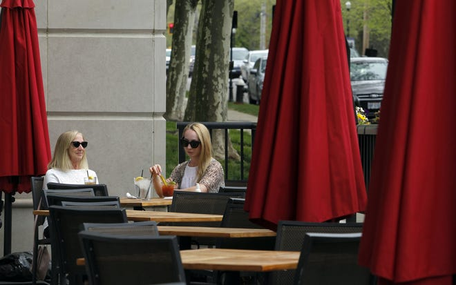 """Lisa Bendler and her daughter, Lindsay Goodman, enjoy the afternoon on the patio April 28 at the Rusty Bucket Restaurant and Tavern, 2158 E. Main St. The establishment is among the businesses in the """"Bexley Patio,"""" which is the DORA approved by  City Council on April 27."""