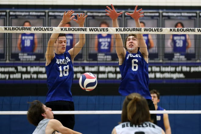Kilbourne's Kieran Cummings (left) and Ben Fisher leap to block the ball during a match against Westerville Central on April 19. The Wolves were 12-3 before playing Pickerington North on April 30.