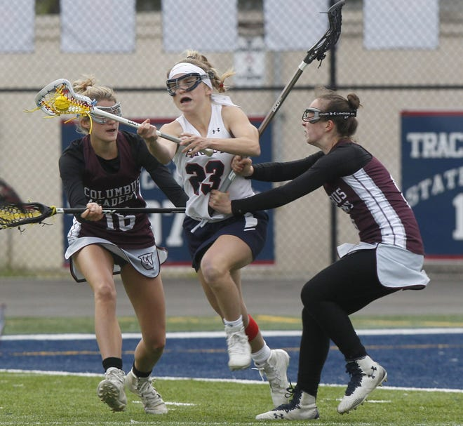 "Senior Sydney Onega (center) has been doing a bit of everything for Hartley this season. ""She's great at 50-50 ground balls, possession, dodging, shooting accuracy and she gets shots off. She's great at lots of things,"" coach Molly Gilbert said."