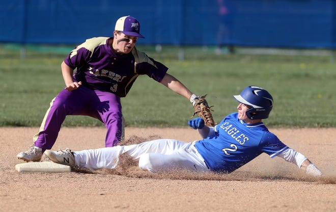 Grove City Christian's Joseph Phillips slides safely into second base past Millersport's Mason Reynolds during the Eagles' 11-7 home loss April 26. Phillips scored a team-high 10 runs through 11 games.