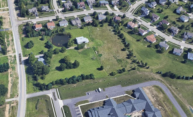 Orange Township trustees voted 3-0 June 21 to approve a plan to develop about 5 acres adjacent to the Inn at Bear Trail with 22 age-restricted, 55-and-older single-story condominium units.