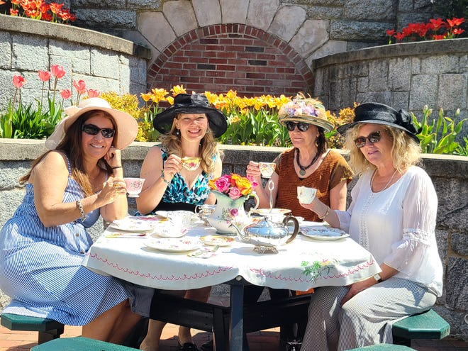 A tea party is held among the tulips below the terraced gardens of Sweatt Memorial Park in downtown Wrentham.