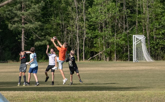Children play football on the lower soccer fields at Nettles Park in Clemson, S.C. Tuesday, April 27, 2021.