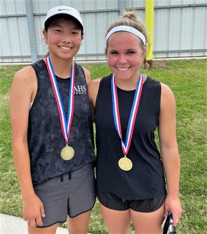 Abilene High's Ruth Hill, left, and Kaitlyn Strain show off their gold medals after winning the girls doubles title at the Region I-6A tennis tournament Wednesday in Midlothian.