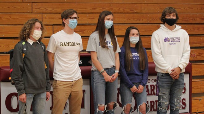 From left to right: Owen High School's Trevor Nail, Sam Hey, Laila Burk, Hannah Larios and Caleb Scott at the school's signing ceremony.