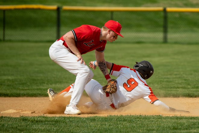 Cherokee's Evan Brown (9) is tagged out by Lenape's Tyler Davis (2) Wednesday, April 28, 2021 in Marlton, N.J. Cherokee won 5-1.