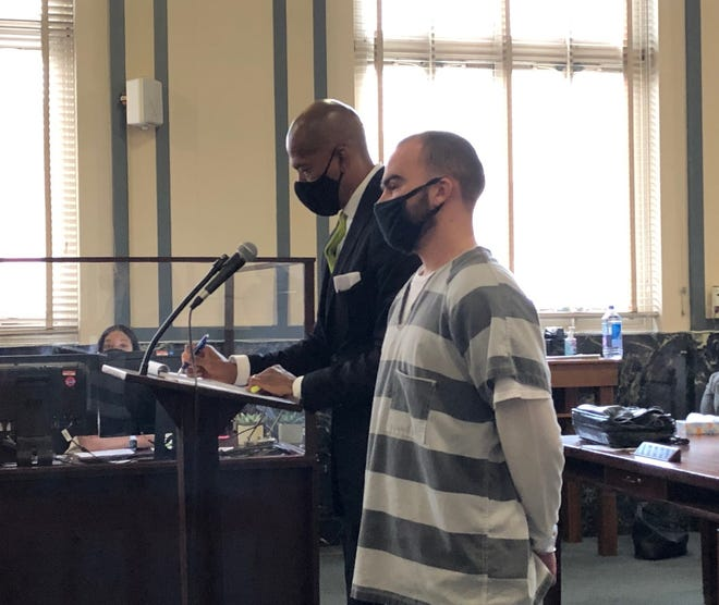 Brandon Marksberry, at right, stands next to his attorney, Clyde Bennett II, during his sentencing in Hamilton County Common Pleas Court on Wednesday, April 28, 2021.
