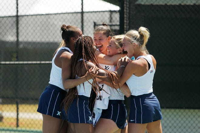 Xavier University's women's tennis team celebrates winning the Big East Conference championship on Monday, April 26, 2021. The Musketeers earned an automatic bid into the NCAA Tournament.