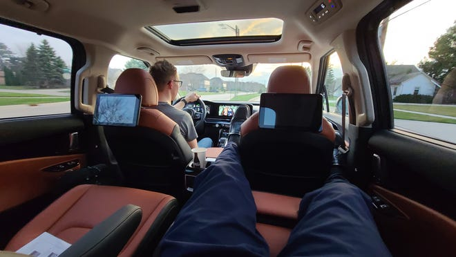 The 2022 Kia Carnival SX Prestige features second-row recliners with arms and foot rest. Detroit News auto critic Henry Payne kicks back.