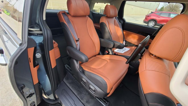 The 2022 Kia Carnival SX Prestige trim offers fancy Barcaloungers for the second row.